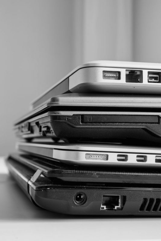 stacked laptops of various sizes